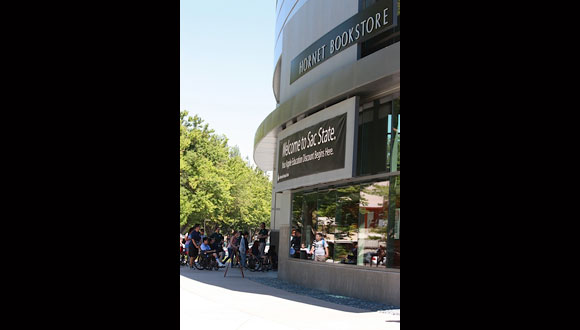 Delegates taking a tour of California State University Sacramento bookstore