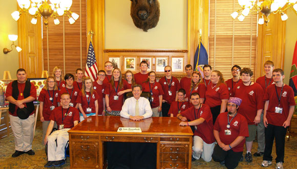 The 2012 Kansas YLF delegates pose for a picture with Governor Sam Brownback at the State Capital.